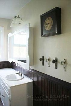 Love this vintage door knobs being repurposed as towel hooks!
