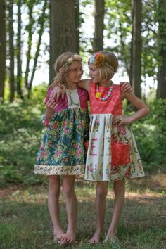 Left: SECRET GARDEN DRESS Right: ALPHABET PARADISE DRESS Beautiful fabric by Bari J!