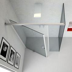 Puerta del cubo de la ducha abisagrada de modo que la amplitud necesaria para abrirla es menor y de tal modo salva espacio.