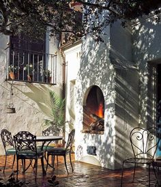 A fireplace on the brick patio