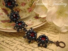 Etna - elegant bracelet beaded with glass beads and red glass rivolis, handmade women's jewellery.