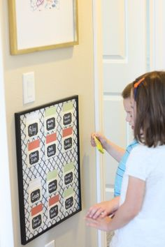 Chore chart - change paint swatches from red to green once chore is done.  Above kids name is their score card.  Each night they get a check mark if all chores done for the day.  At end of week get full allowance if all checks.