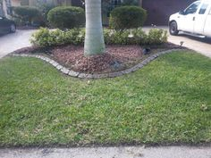 Decorative concrete Curbing in Fort Myers FL. This pattern is custom stone in multi earth tone colors. Concrete Curbing, Concrete Driveways, Landscape Curbing, Fort Myers Florida, Decorative Concrete, Earth Tone Colors, Cape Coral, Sidewalk, Deck
