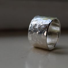Hey, I found this really awesome Etsy listing at http://www.etsy.com/listing/110815851/rustic-wide-and-heavy-silver-ring