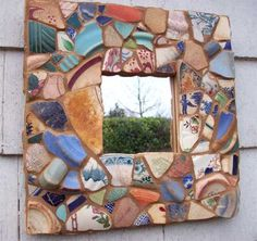 The sand colored grout with sea glass pottery is really harmonious.