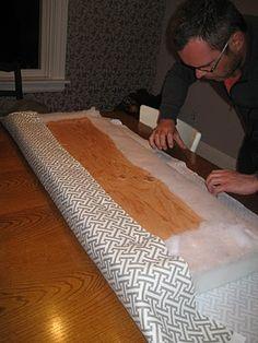 Buy foam attach to plywood wrap with batting then staple batting down. Buy foam attach to plywood wrap with batting then staple batting down. Wrap with fabric then staple down.