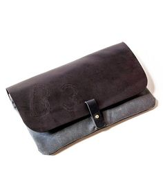 Type: Clutch / Size: Small / Color: Black, Grey / Details: Embossed, Snap Closure / Material: Leather