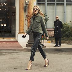 Leather culottes, a black turtleneck and a high street military jacket complete this playful look.
