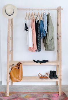 Two ladders make a unique closet storage solution