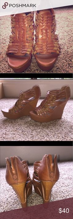 Gianni Bini brown cage wedge sandal Gianni Bini brown cage sandal with woven cage details. The wooden platform base gives an added edge to these tall, yet comfortable wedges. They're great to wear for all summer events, and the foot stays secure. Thanks for looking! Gianni Bini Shoes Wedges