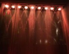 Weinstein Company Golden Globes 2014 After Party: A programmable water wall bar backdrop rotated through text and patterns for a hypnotizing effect.