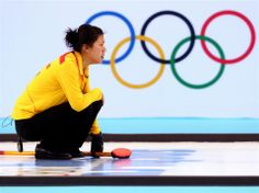 Zhou Yan of China in action during Curling Women's Round Robin match between China and Denmark on day 9 of the Sochi 2014 Winter Olympics at Ice Cube Curling Center