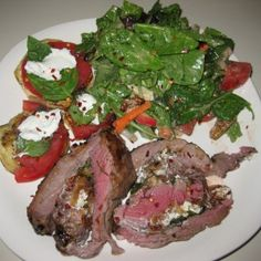 leg of lamb stuffed with goat cheese, figs and fresh basil with balsamic glaze