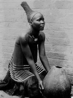 Africa | 19th century Zulu women created cone shaped upward coiffure designs. | Photographer ?