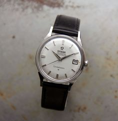 This Omega Constellation 1966 is a true classic. Understated and elegant featuring the white dial with steel hands and baton markers. Excellently complemented by the stainless steel case. On the reverse is found the famous logo depicting the Geneva Observatory. The reference number 168.005 indicate that this is a self-winding gentleman's chronometer. Measuring 35mm in diameter, it has a signed crown and houses the original 24 jewels calibre 561 automatic … Read More →
