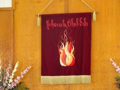 """The """"Jehovah Ahel Esj"""" Banner (Our God Is A Consuming Fire) made in Oamaru, New Zealand in 1983..."""