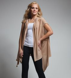 Site that shows you how to wear the DIY all in one wrap/blouse/cardigan/head scarf/poncho/shoulder scarf/shrug/stole/tunic/turtleneck!