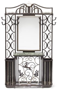 An Art Deco wrought iron mirrored hall stand second quarter 20th century.