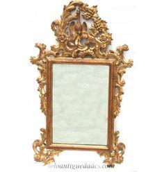 Majestuosa pareja de espejos de pared, rectangulares, estilo Luis XVI. Marco de madera, abocelado, dorado y tallado con grandes volutas. Copete con ganso o cisne, incluido en una orla formada por hojas de acanto, flores de parra y racimos de uvas  #Espejos