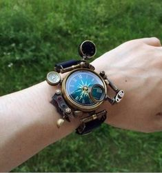 IDEA: This, but with a compass instead of a watch. The same substitution would work on any other accessible steampunk jewelery, especially lockets (or just hidden under some sort of disguised cover Moda Steampunk, Design Steampunk, Costume Steampunk, Steampunk Kunst, Style Steampunk, Steampunk Watch, Steampunk Clothing, Steampunk Fashion, Fashion Goth