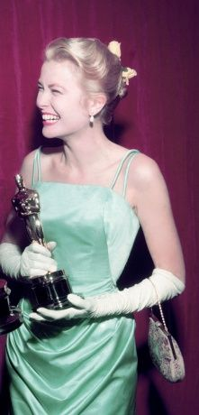 Grace Kelly after winning the 1955 Oscar in this mint green Edith Head gown.
