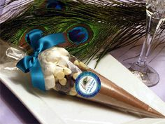 Winter is a wonderful time of year snuggling with loved ones and warming the tummy with hot chocolate especially after skiing, sledding, building snow forts, or just having a grand time watching millions of snowflakes dancing in the sky. And our PEACOCK Hot Cocoa Cone favor is the perfect gift that your friends and family will enjoy.