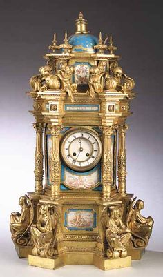 "*A Large ""Sèvres"" Porcelain and Gilt Bronze Mantel Clock, 19th c., the works marked by Japy Freres, Paris, of tabernacle form, the domed top supported by Corinthian columns, the porcelain plaques showing trophees and allegorical figures of the Continents."