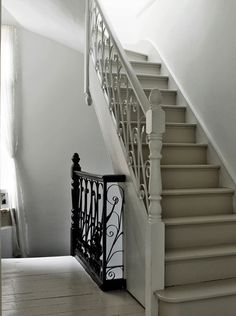 Love the mix of wood banisters and metal scrollwork! via Modern Country Style: Modern Country Edwardian House Tour Timber Stair, Modern Stair Railing, Modern Stairs, Staircase Design, Painted Staircases, Painted Stairs, Entry Stairs, House Stairs, Cottage Stairs