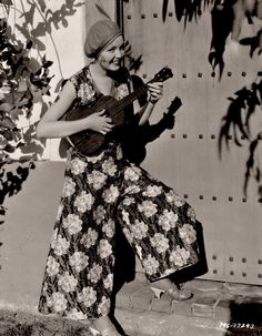 Circa 1930. Catherine does a little charming with her Martin tenor ukulele on…