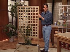 Goofy lookin' guy, but perfect DIY trellis with planter for use as privacy around outdoor hot tub. I plan to fill the planters with polished river stone for an outdoor zen/spa feel and look