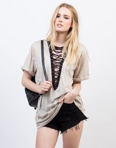 Deep V is key. This taupe Lace-Up Deep V Tee will keep you comfy from day to night. Pair this oversized tee with black skinny jeans and ankle booties for a casual day out.