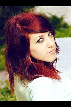 Burgundy red/brown hair.