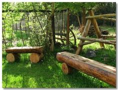 Log benches around the fire pit and by the creek