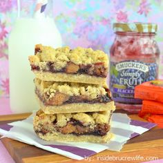 Peanut Butter & Jelly Crumb Bars from Inside BruCrew Life - crumb bars filled with Reeses peanut butter cups and blackberry jelly #peanutbutter #jelly #reeses