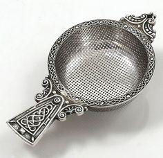 A E Jones English silver tea strainer