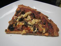 Single slice of seasoned pizza crust, definitely a thin crust.