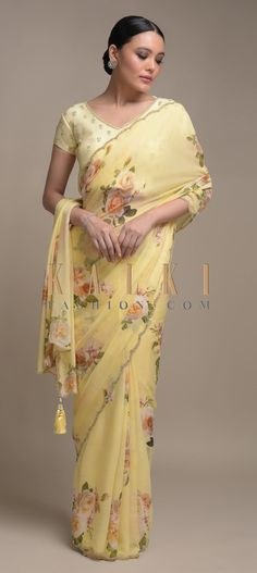 Buy Online from the link below. We ship worldwide (Free Shipping over US$100)  Click Anywhere to Tag Banana Yellow Saree In Georgette With Floral Print All Over Online - Kalki Fashion Banana yellow saree in georgette with floral print all over.Further enhanced with sequins and cut dana work on the scallop cut border.Trimmed with tassels on the pallu.