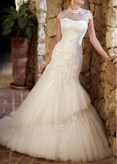This dress seems really romantic. Tulle & Satin With Beaded Lace Appliques Mermaid Illusion High Neck Drop Waist Floor Length Wedding Dress $275 DressilyMe