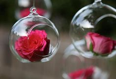 Hanging Globes with Flowers - romantic #wedding #decor inspiration