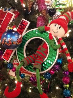 RAZ 2013 Postmark Christmas Elf.....shown sitting in a HO HO HO ornament.....elf is posable))) See more of the RAZ Postmark Christmas Collection at www.trendytree.com
