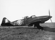 Defiant Mark I night fighter, T4037 'JT-T', of No. 256 Squadron RAF, on the ground at Squires Gate, Blackpool, Lancashire. The retractable fuselage fairings aft of the turret have been lowered for firing. (Background of photograph censored).~ BFD