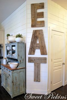 If you've got excess kitchen decor space, this would be a great way to rustically fill that space. u can make is as rustic as you want w/no pretty cut corners. DIY Reclaimed Wood Kitchen Sign [EAT] I'd like this for My far kitchen wall Wood Kitchen Signs, Reclaimed Wood Kitchen, Reclaimed Lumber, Kitchen Decor, Kitchen Ideas, Kitchen Letters, Wood Signs, Rustic Signs, Kitchen Art
