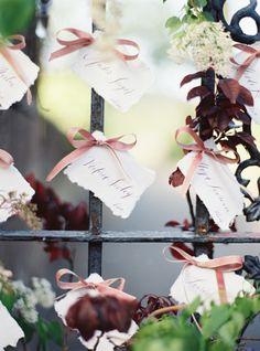 Ribbon tied escort cards: http://www.stylemepretty.com/2015/05/18/purple-garden-glam-wedding-inspiration/   Photography: Jessica Burke - http://www.jessicaburke.com/