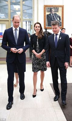 Prince William, left, and Kate, centre, talk to the US Amabassor Matthew Barzun