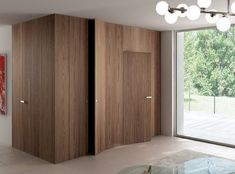wall cladding and flush wood doors from Ghizzi & Benatti Hidden Doors In Walls, Windows And Doors, Inside Doors, Wooden Walls, Wooden Doors, Invisible Doors, Cladding Systems, Interior Architecture, Interior Design