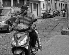 Black and White Street Photography in Guatemala #BlackandWhite #bwpics #LatinAmerica #CentralAmerica #Guatemala #iLoveXela #TravelPics #Xela #Xelaju #VisitXela #Quetzaltenango #StreetPhotography #TravelPhotography #documenting #VisitGuatemala #TravelLiteShootHeavy #picoftheday #photooftheday #StreetPics #actionshots #world_streets #travelphotographer #streetphotographer #getolympus #photographylife #bnw #my_daily_bnw #streetsofguatemala #motorcycle