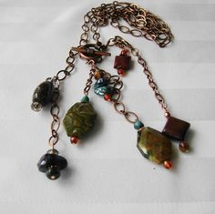 This cluster pendant necklace is a collection of vividly coloured gemstones and lovely antiqued copper. The deep blue labradorite has an intense