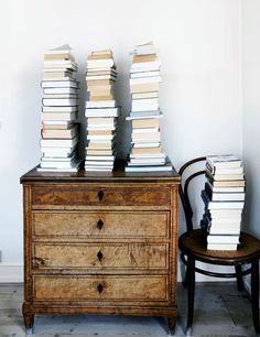 book piles on a thonet chair