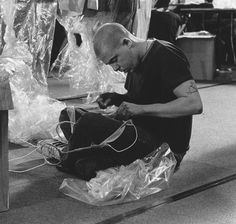 Lee Alexander McQueen backstage at his Spring/Summer 2001 collection entitled 'Voss' photographed by Anne Deniau