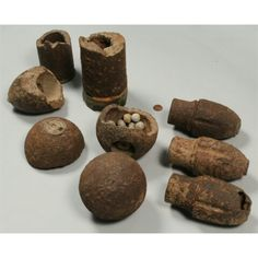 Collection of excavated Civil War artillery shells and fragments including a possible Confederate shell, grape shot, Schenkal, and solid cannon ball. 9 items plus approximately 24 mini balls. All found circa 1920 on owner's family property, part of the site of the Battle of Peachtree Creek in Atlanta, GA. Private Atlanta, GA collection.